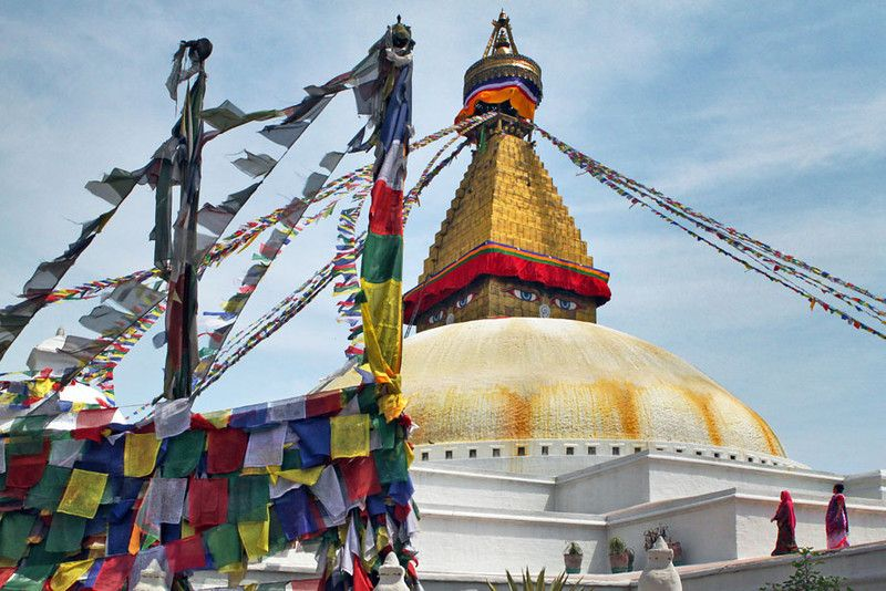 Prayer flags and all-seeing-eyes at Boudhanath Buddhist Temple in Kathmandu, Nepal