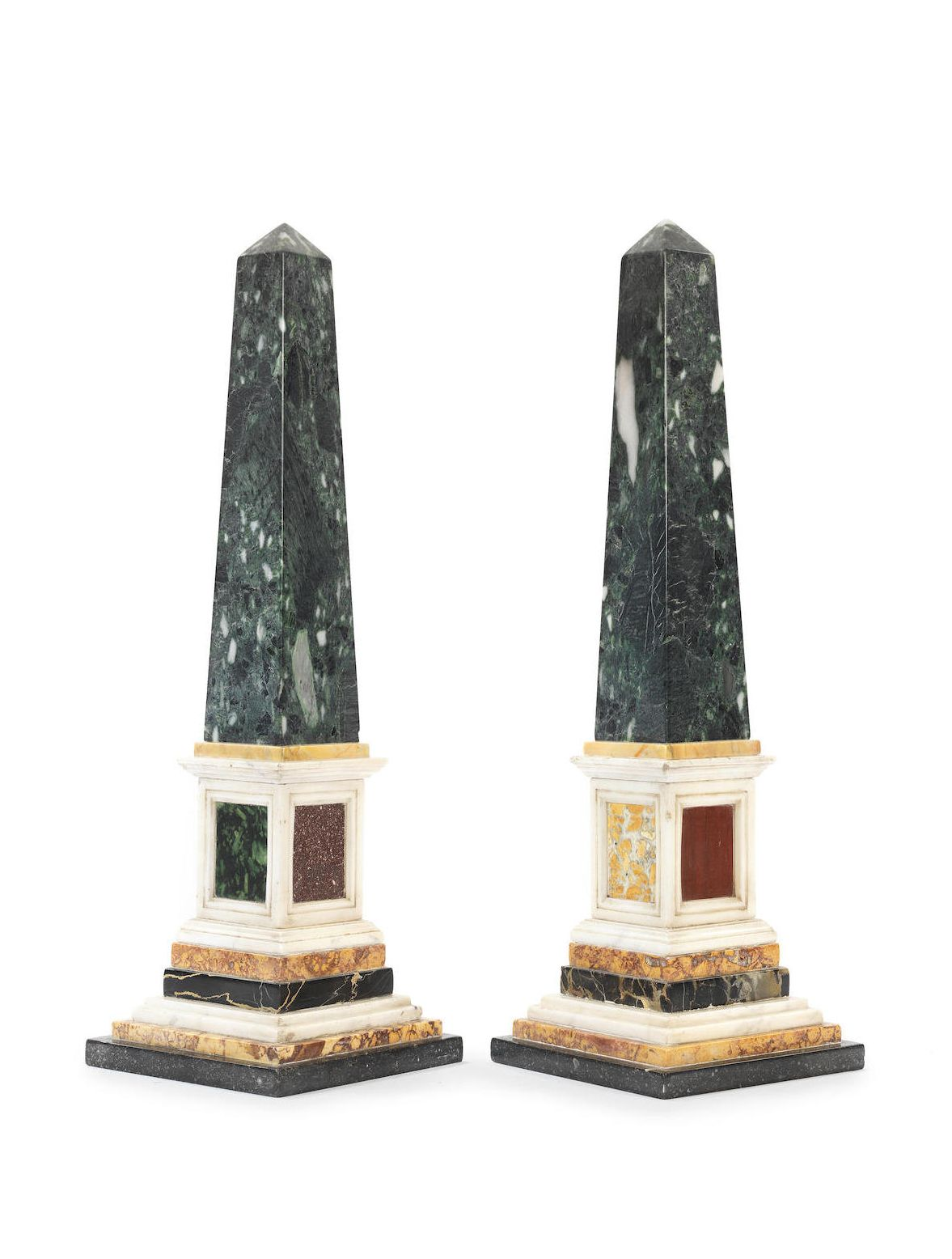 A Pair Of Decorative Specimen Marble Obelisks In The 19th Century Style The Tapering Verde Antico Shafts On White Sienna Yellow And Other Coloured Marble Mould