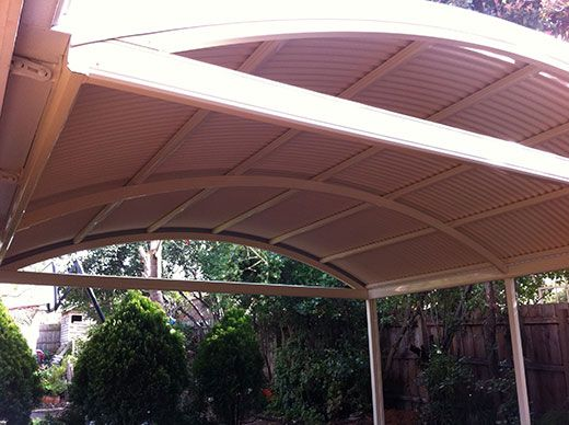 How To Make An Interesting Art Piece Using Tree Branches Ehow Curved Patio Pergola Curved Pergola