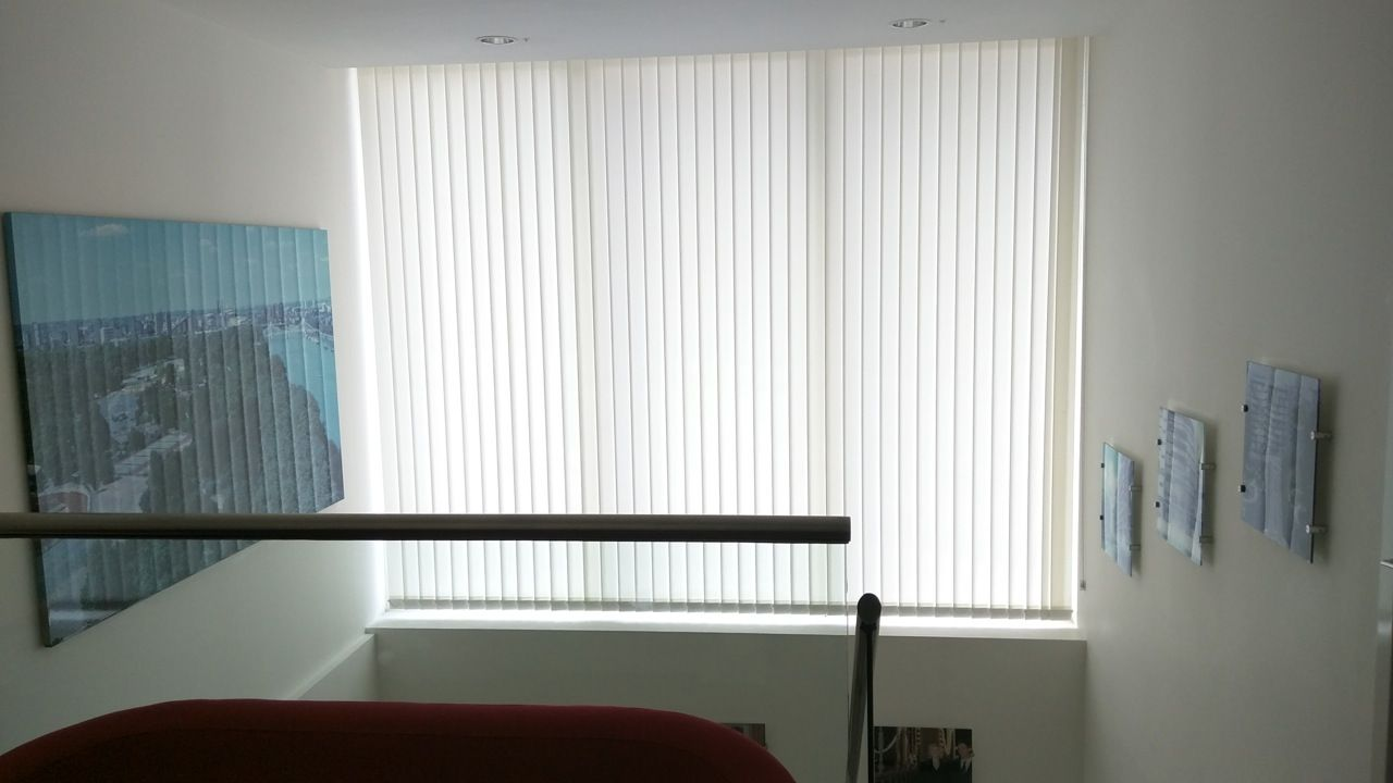 Vertical blinds to staircase window installed by The Blind