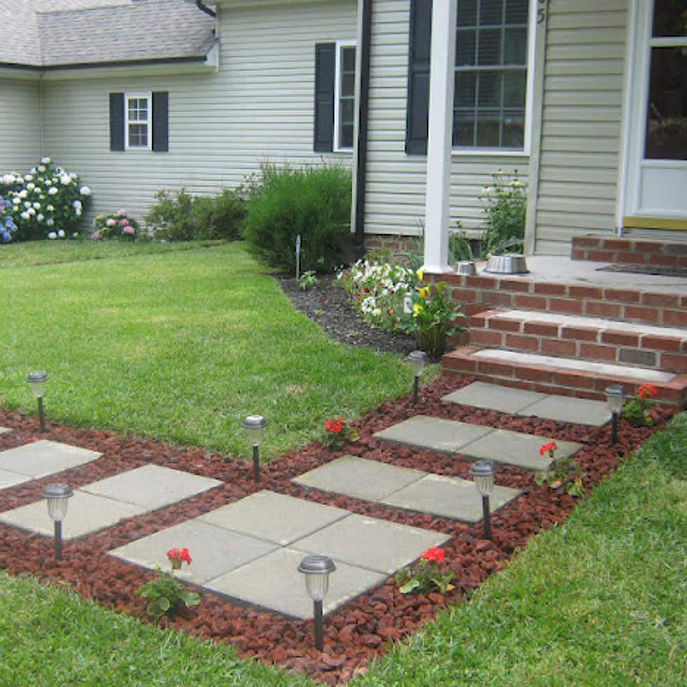 Front Walkway Built Out Of Inexpensive Cement Pavers Red Lava Rocks And Solar Lights