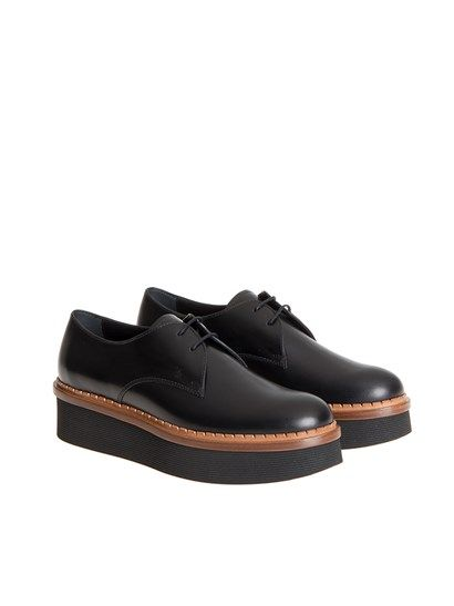 9ddbddc620f0 Black leather derby shoes with tan colored edge detail