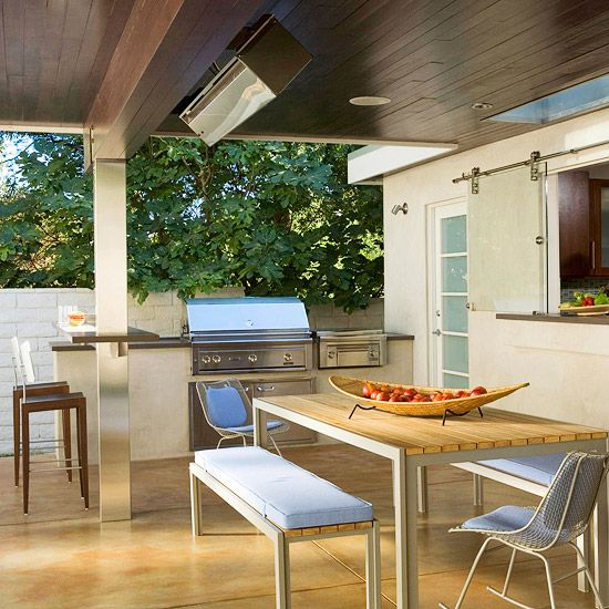 like this modern outdoor kitchen & the barndoor window for the slide through from the kitchen. very nice