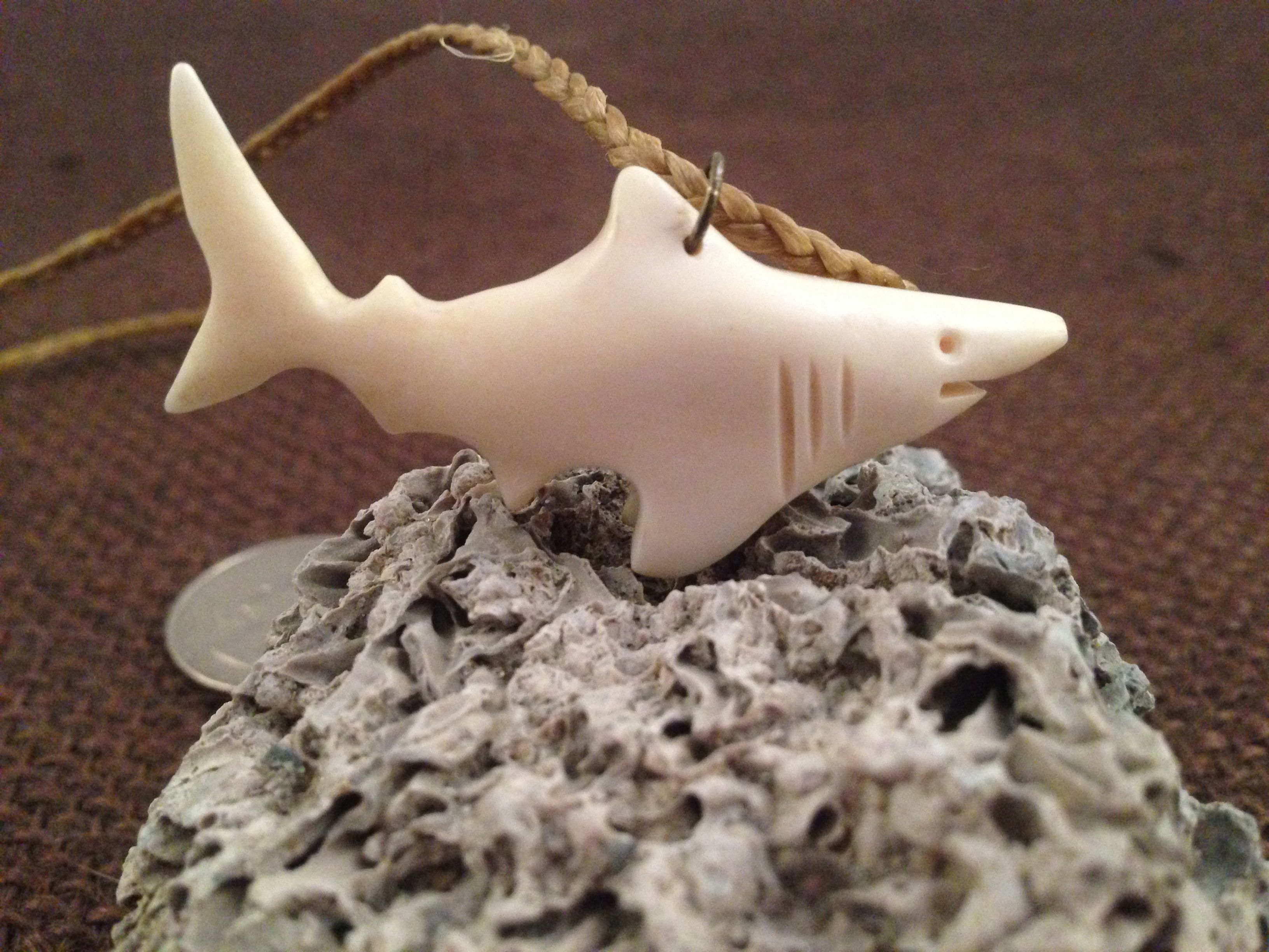 Handcarved shark pendant in bone with braided cotton cording necklace.  Commissioned piece - Three Cedars Artisans.