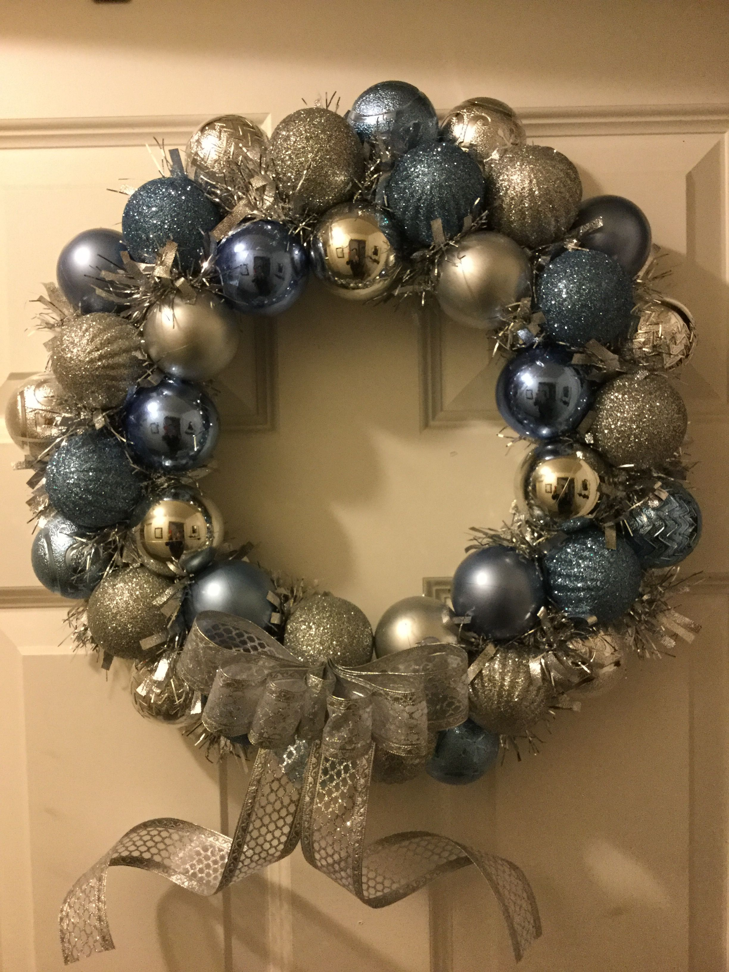 Easy diy wreath made of Christmas ornaments on a wire ...