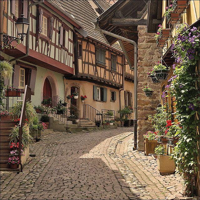typical alley in eguisheim medieval france and alsace. Black Bedroom Furniture Sets. Home Design Ideas