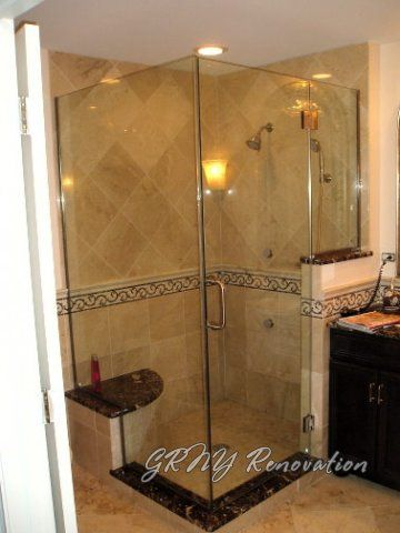 stand up shower with rain head, body sprays, bench seat, shower