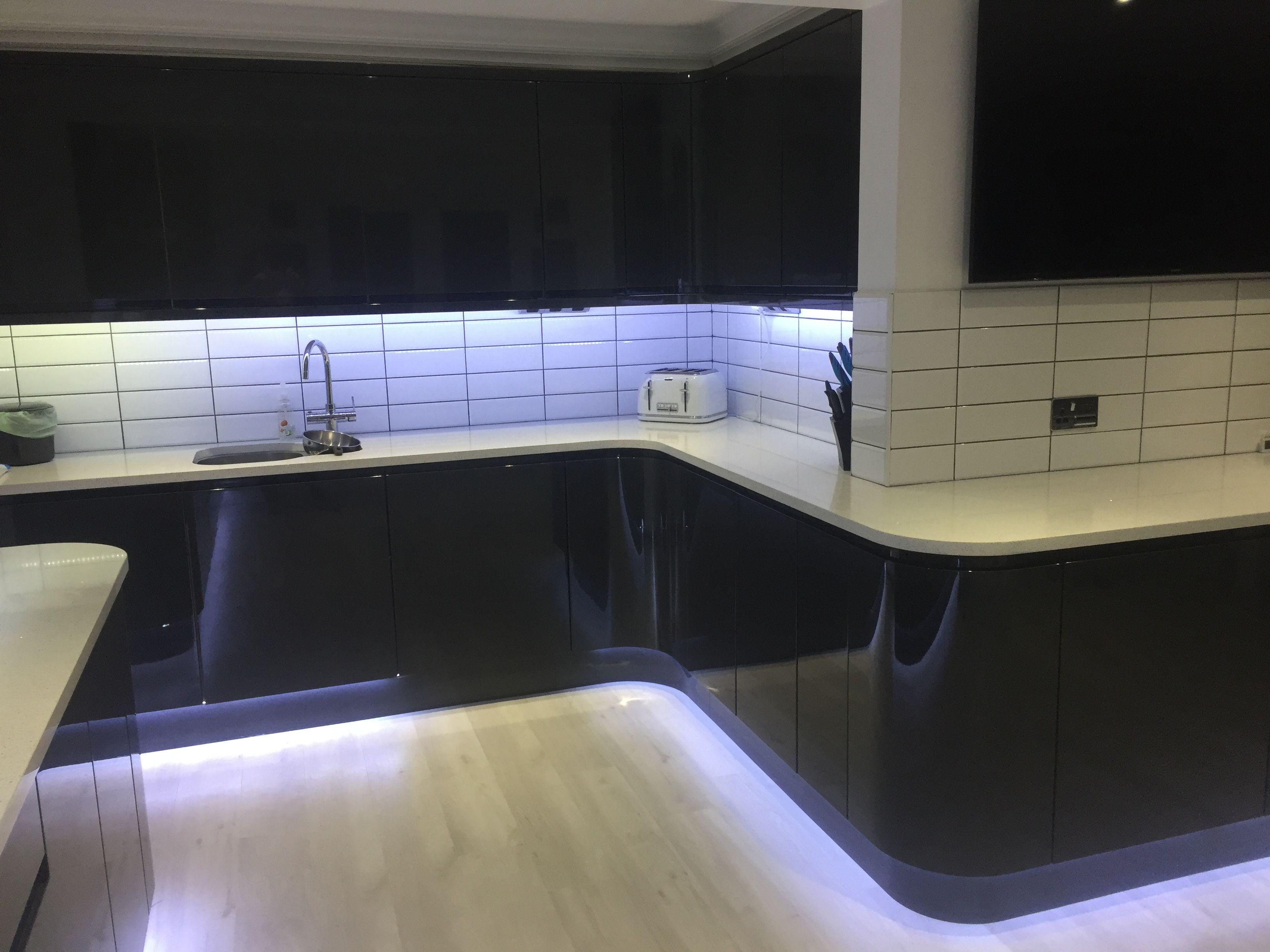 Dark grey gloss kitchen, white subway tiles, white quartz worktop ...