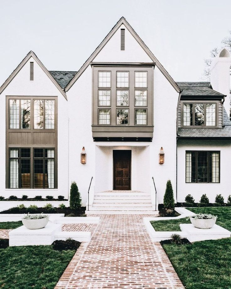 I love this exterior. The white brick, and the windows. How would it ...