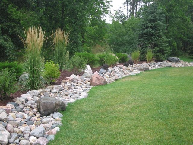 For Bottom Of Hill In Backyard Maybe Do A Border Between Grass And Gravel Landscaping On A Hill Backyard Landscaping Landscaping With Rocks