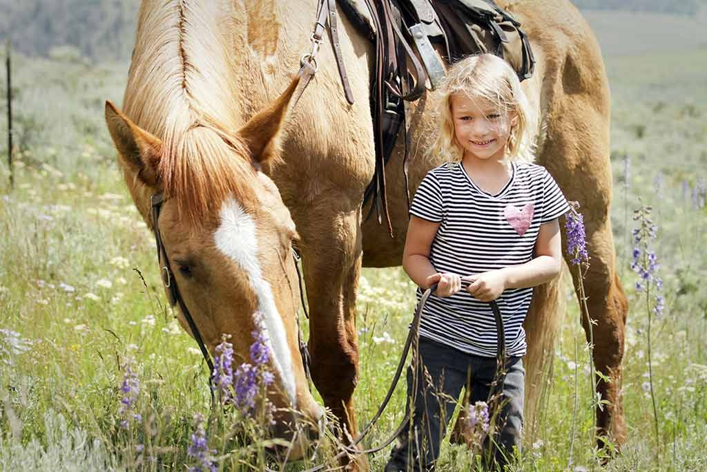 By the end of the day, the kids hate to leave their horses after such a fun time on their horseback riding vacation!