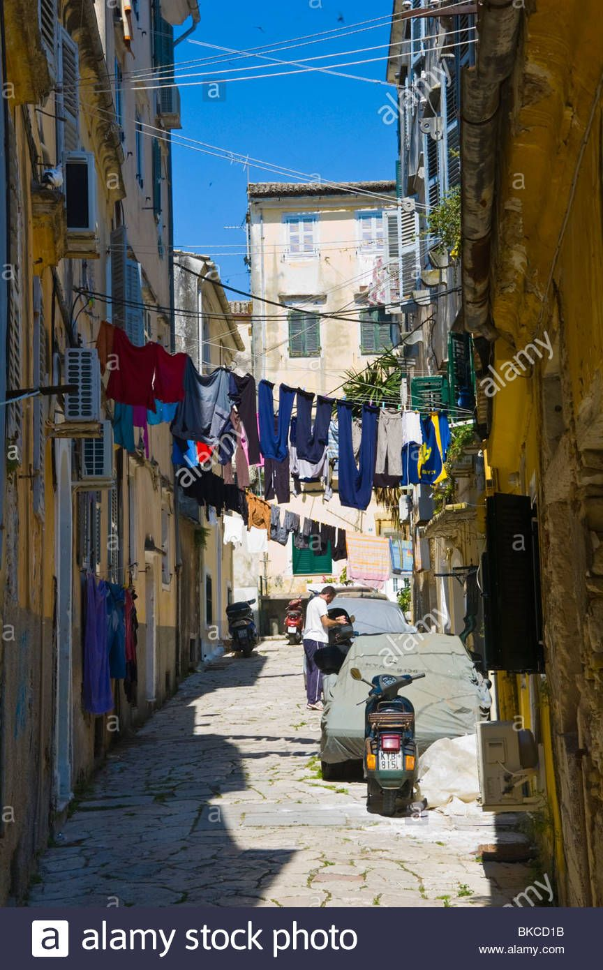 Washing Lines Strung From Apartments On Narrow Alleyway In Corfu
