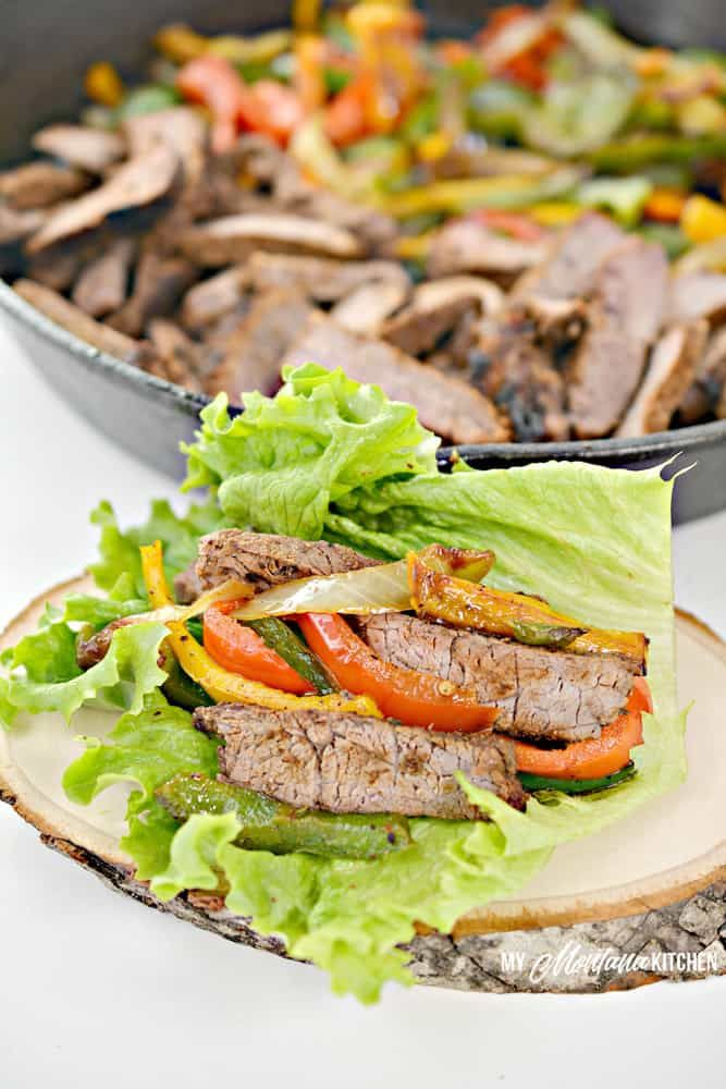 Tender and juicy sirloin steak topped with a delicious mixture of onions, peppers, and lettuce will make these steak fajitas lettuce wraps recipe one of your favorite go-to meals. #lowcarbdinner #ketofajita #trimhealthymama #steakfajitarecipe