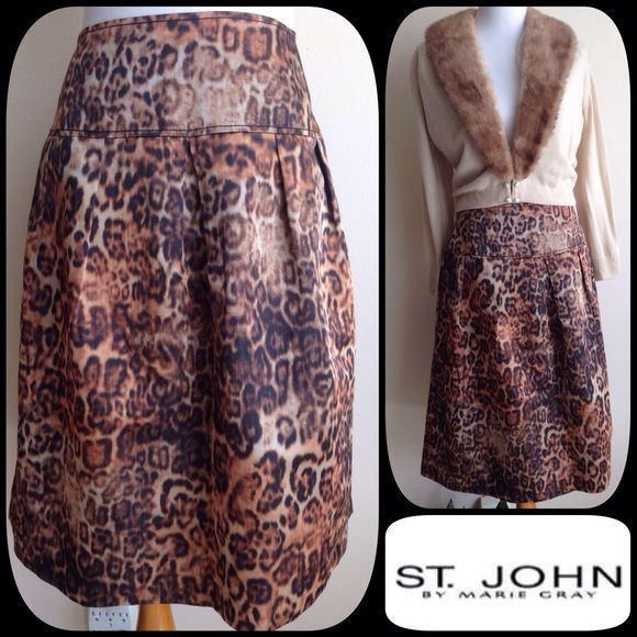 Flash Sale St John Leopard Skirt Beautiful St. John Silk Sateen Leopard Skirt. Dropped waist with yolk, side zip. Full skirt. . Dress it up with a blouse or Vintage cardigan (also for sale in my closet ) or wear it more casual with a sweater and boots. Like new and perfect. St. John Skirts