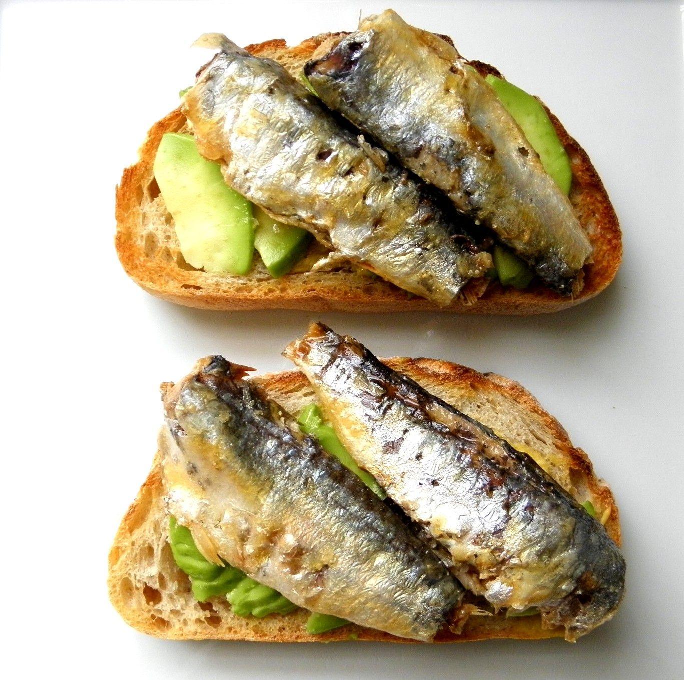 sardine avocado toasts with a medium cooked egg