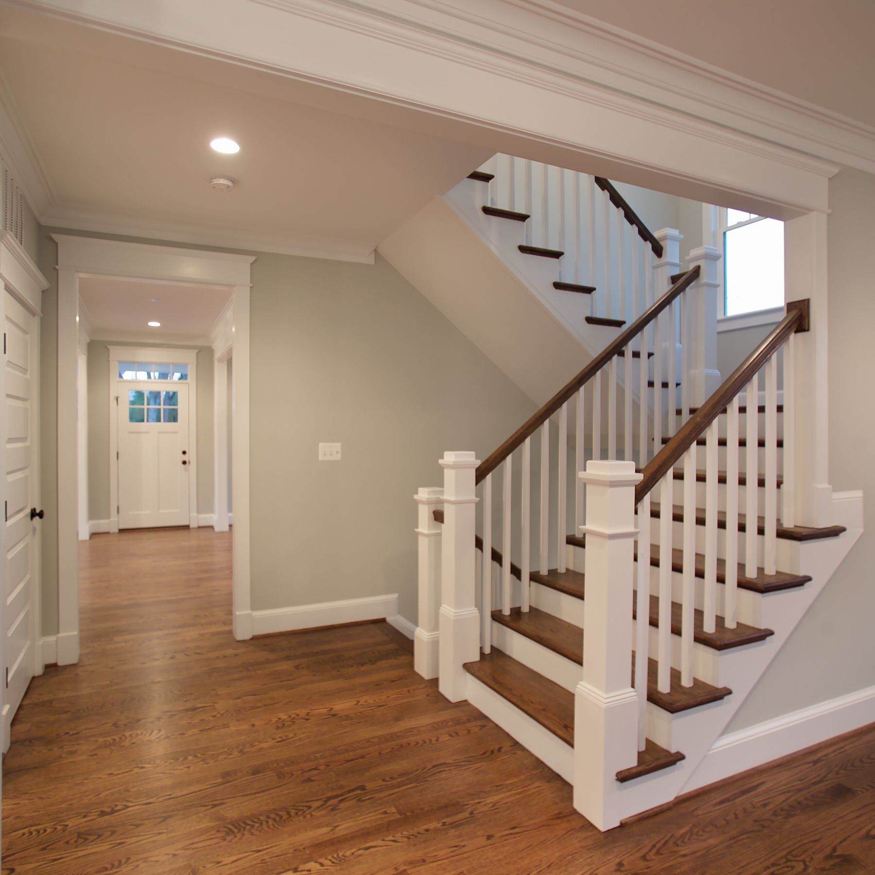 The Beautiful U Shaped Stair Has Hardwood Treads And Handrails With Painted  White Risers,