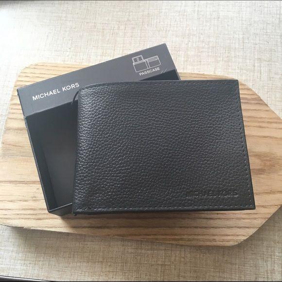 Michael Kors men's Passcase wallet. NWT NWT leather Michael Kors Passcase wallet. Black. Comes in original box Michael Kors Bags Wallets
