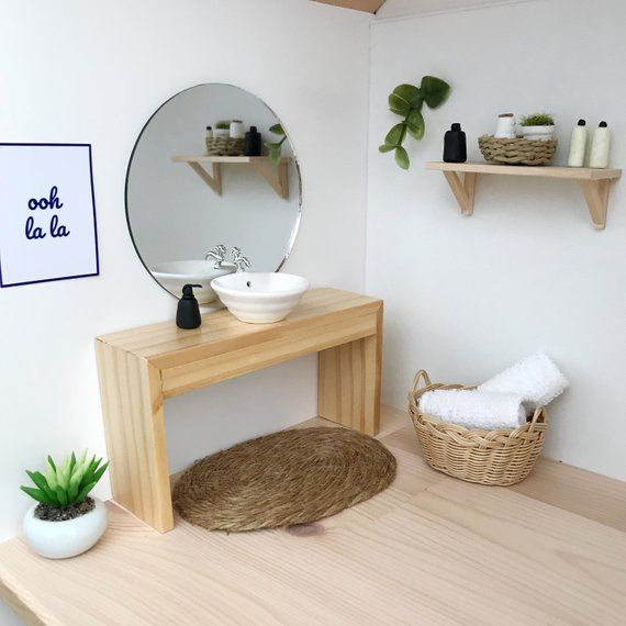 Photo of Modern dollhouse bathroom vanity with freestanding round sink or square sink
