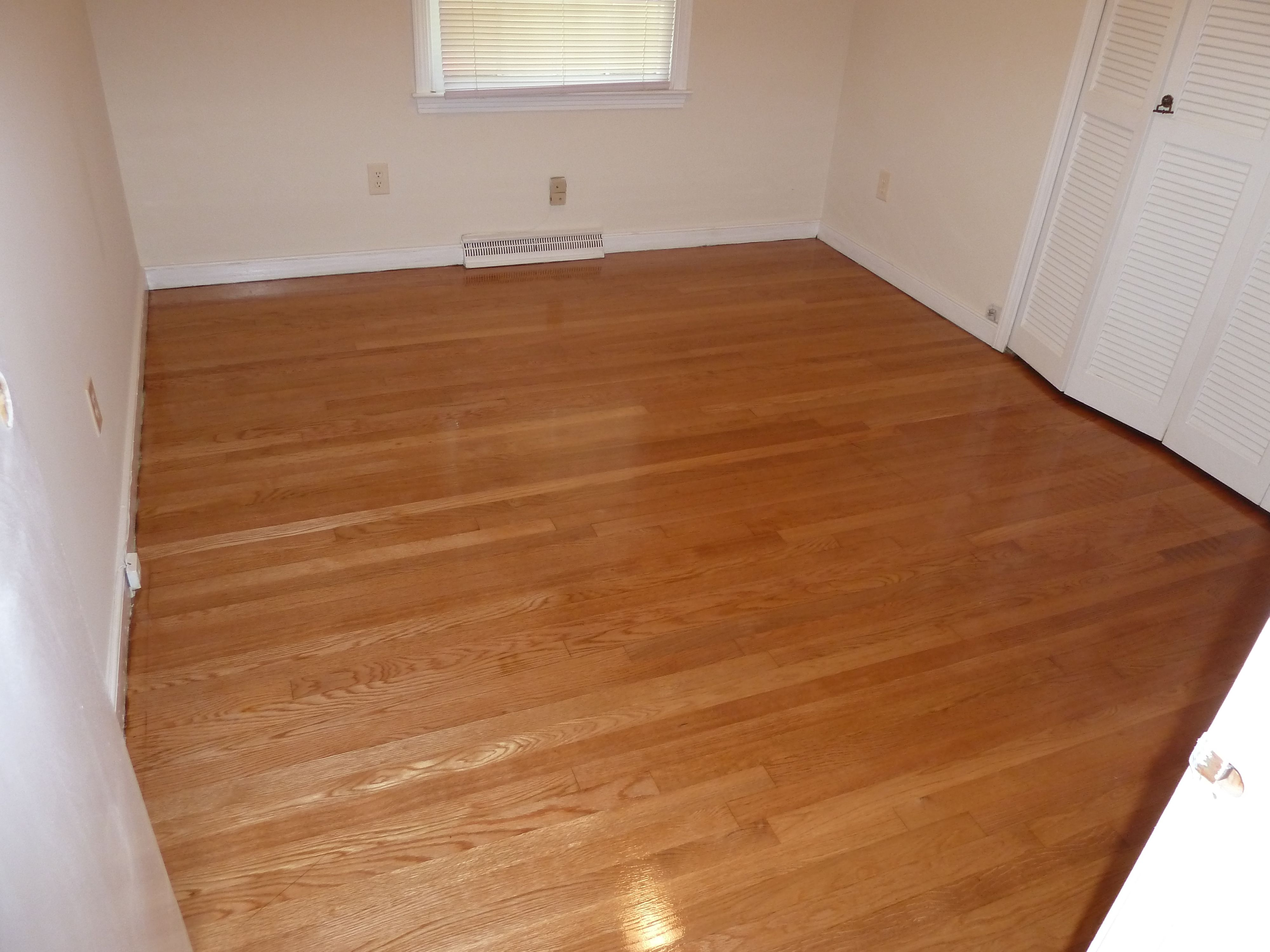 Natural Red Oak floor coated with a gloss finish Oak