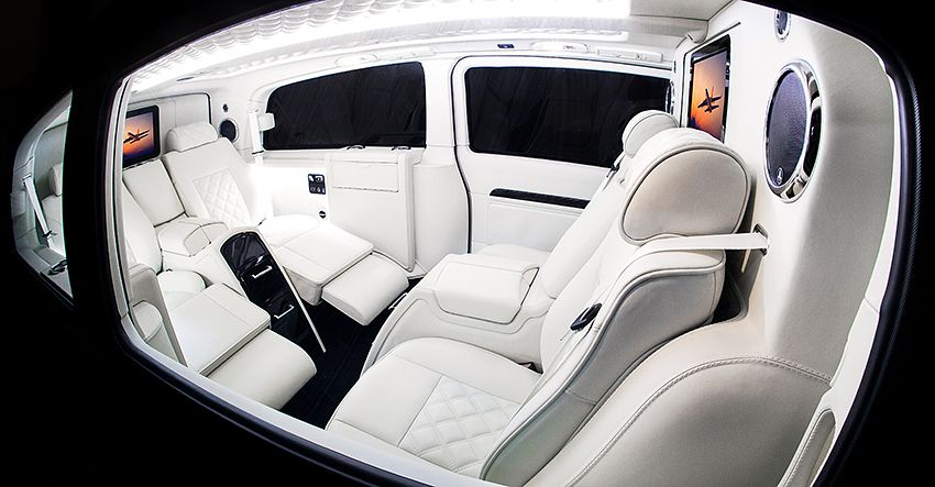 side on view of bespoke RV white leather interior | Luxury suv