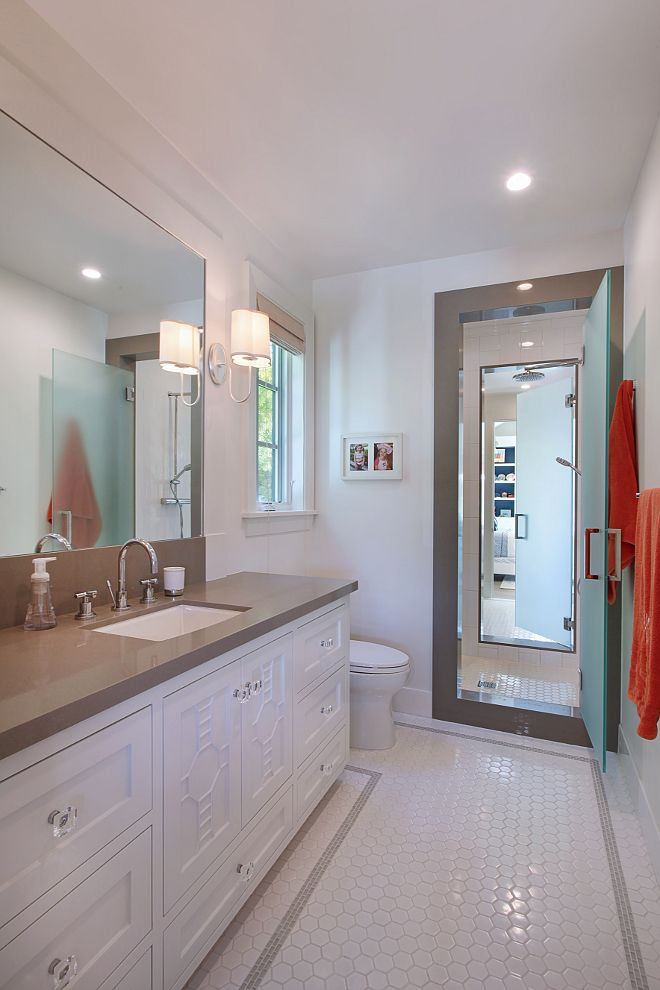 Jack And Jill Bath Has Shared Shower With Opaque Glass Doors - Jack and jill bathroom remodel ideas