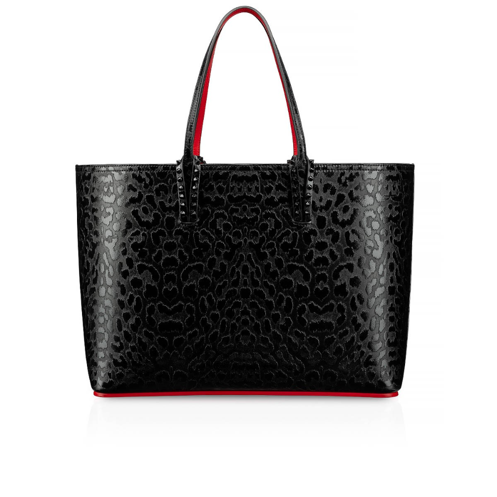 Christian Louboutin S Cabata Is A Go To Tote That Is As Sophisticated As It Is Versatile Black Metal Spiked Loops Anch Black Tote Bag Christian Louboutin Bags