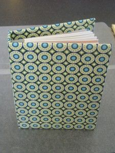 Covering books in fabric. These look so pretty. I'll have to try it.