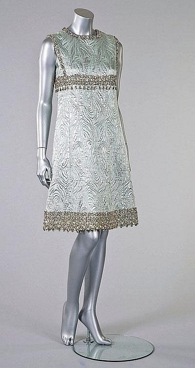59c97d5edb7 An Yves Saint Laurent Patron Original silver and blue-grey brocatelle cocktail  dress, circa 1966, labelled and numbered 016651, the borders with elaborate  ...