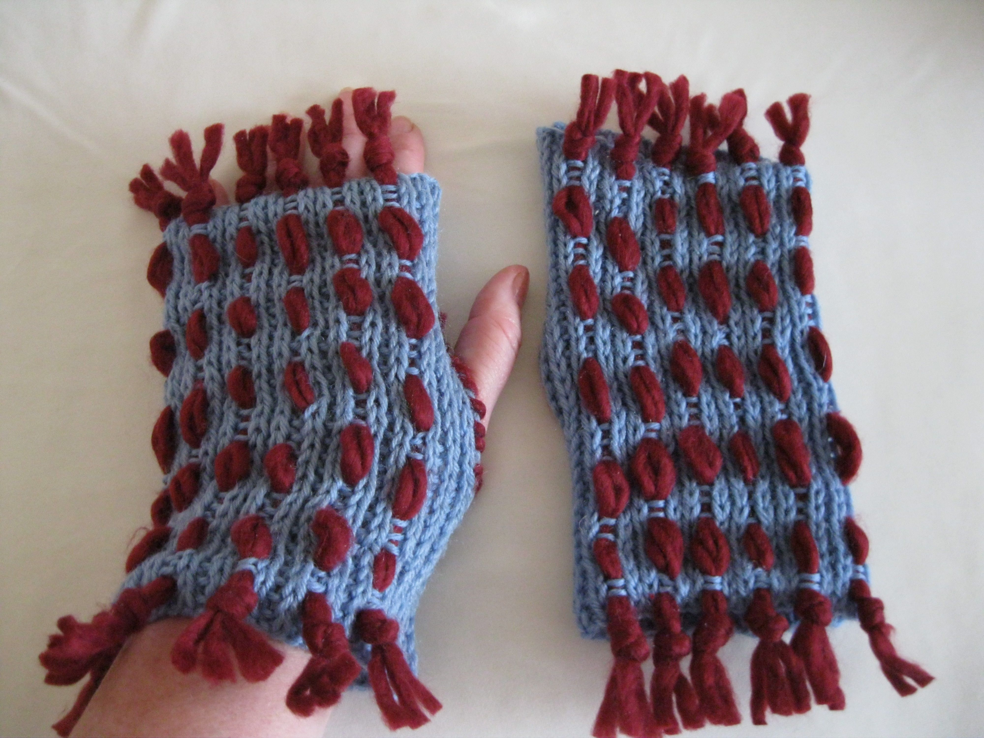 Hand-knitted mittens.