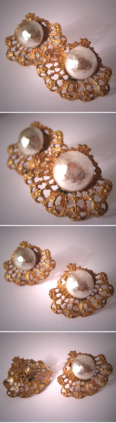 ed Backings. These wonderful classic pieces are made by Miriam Haskell, circa 1960's. They hold her signature glass baroque pearls at their centers with a wonderful lustrous glow. The settings are signature Russian gold gilt filigree with lovely detailing. The backings have post