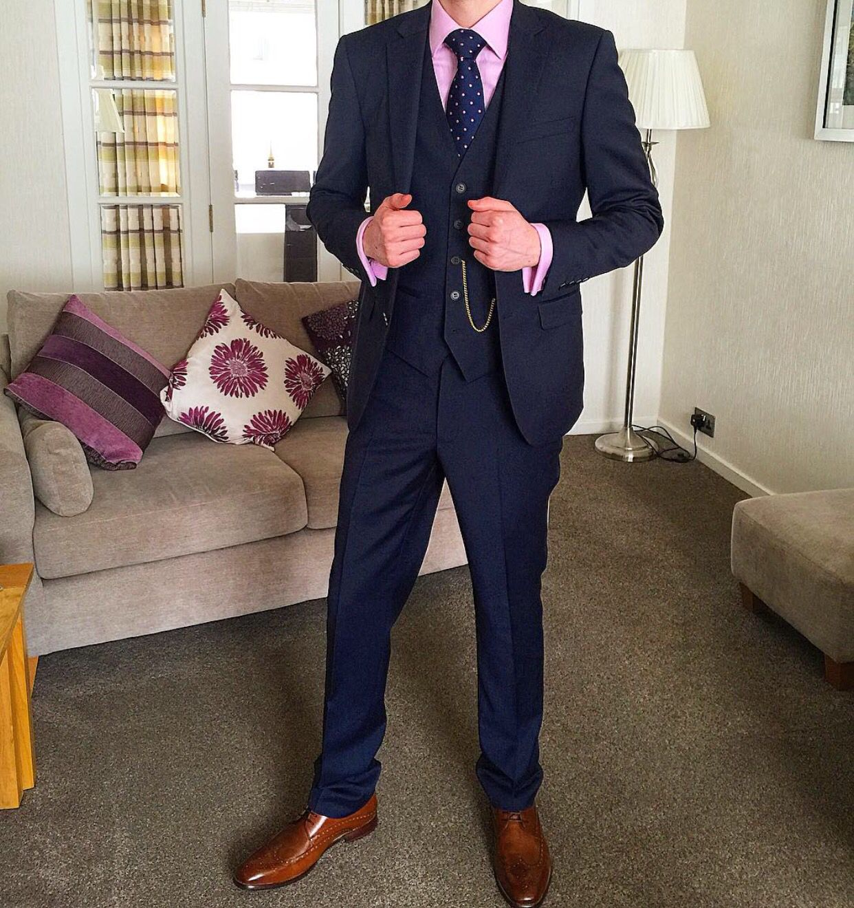 10586ad3 DKNY men's navy suit with pink shirt, navy tie and brown brogues ...