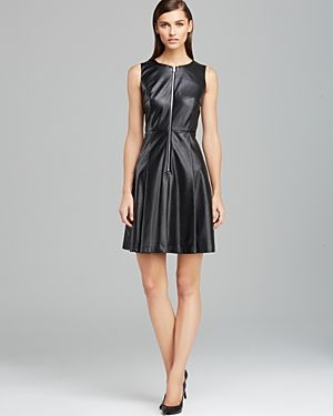$149, Black Leather Skater Dress: Calvin Klein Perforated Faux Leather Flare Dress. Sold by Bloomingdale's. Click for more info: https://lookastic.com/women/shop_items/275574/redirect