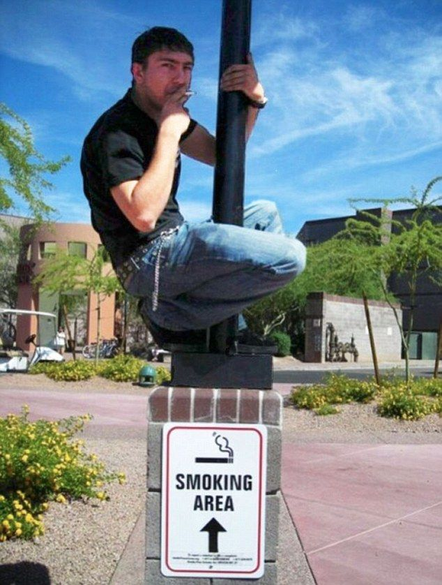 This smoker climbed on to the post to have his cigarette, no doubt following the direction of the arrow