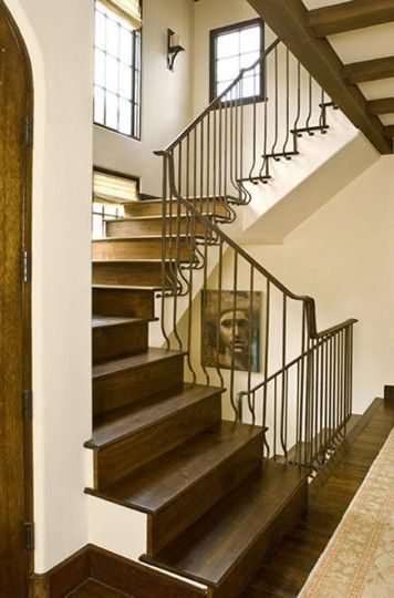 Foyer With Wrought Iron Railing Staircase From Traditional Home