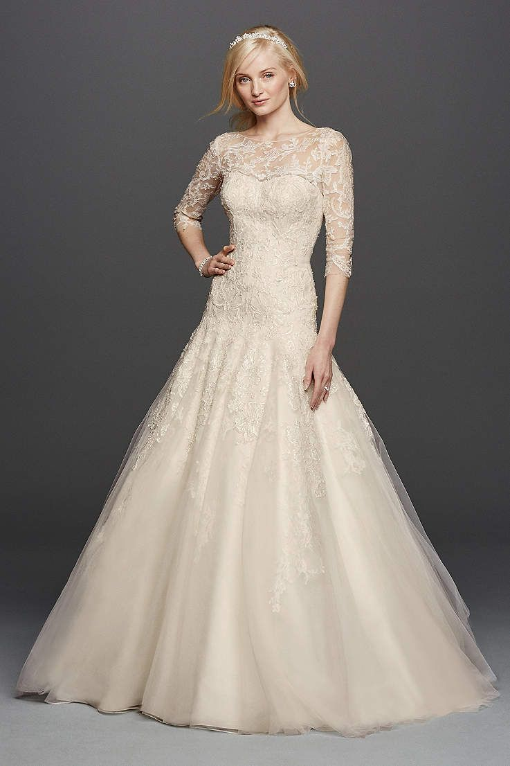 7afb1cb7904aa Made for the modern princess, this classic organza ball gown was designed  with three-quarter lace sleeves and a flattering sweetheart neckli… |  Wedding ...
