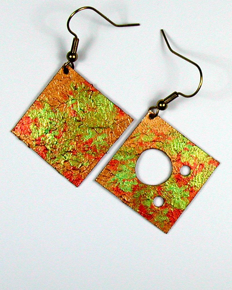Hand-made, exceptionally high quality earring made from very lightweight and durable brushed aircraft aluminum.  They are hand painted with bright acrylic iridescent and duochrome colors and color combinations.  http://shop.dennisfehler.com/product-category/earrings/