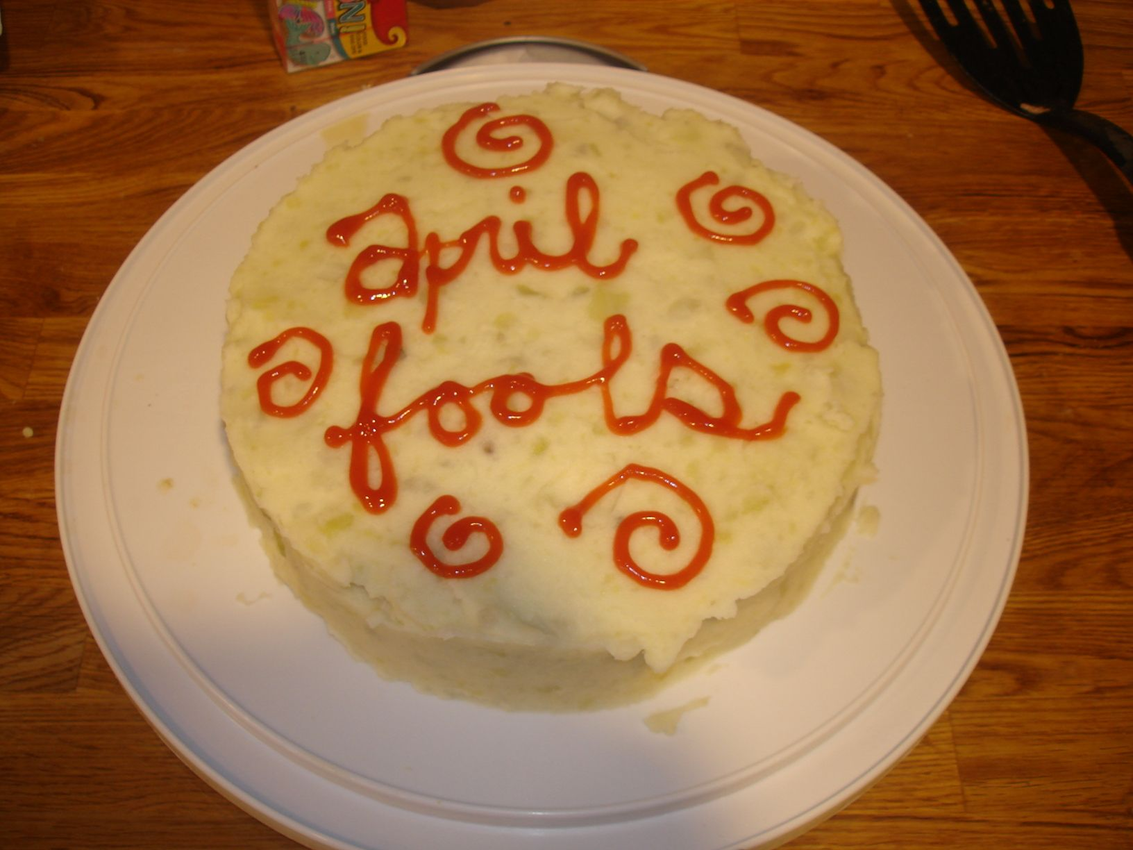 "April Fools day cake.  I made meatloaf in two cake pans and ""frosted"" both layers with mashed potatoes."