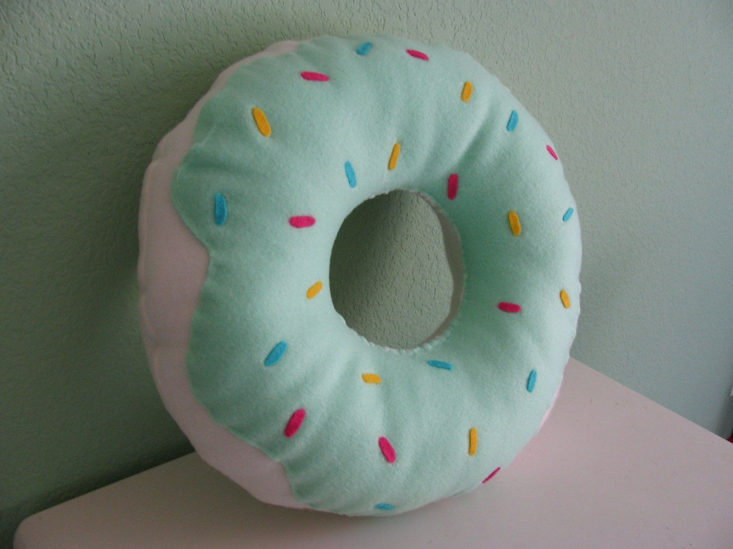 large donut pillow via etsy super