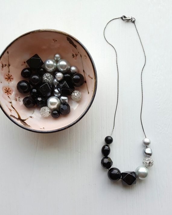 a kiss at midnight necklace - vintage lucite - colorblock - black and silver necklace