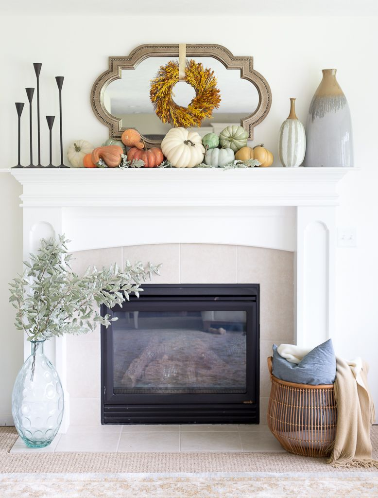 A soft and simple fall mantel using pumpkins and fall items. Decorative  pieces from HomeGoods