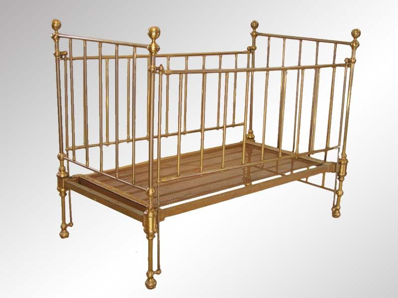 Infant beds are a historically recent development intended to contain a child capable of standing. antique brass baby crib antique baby