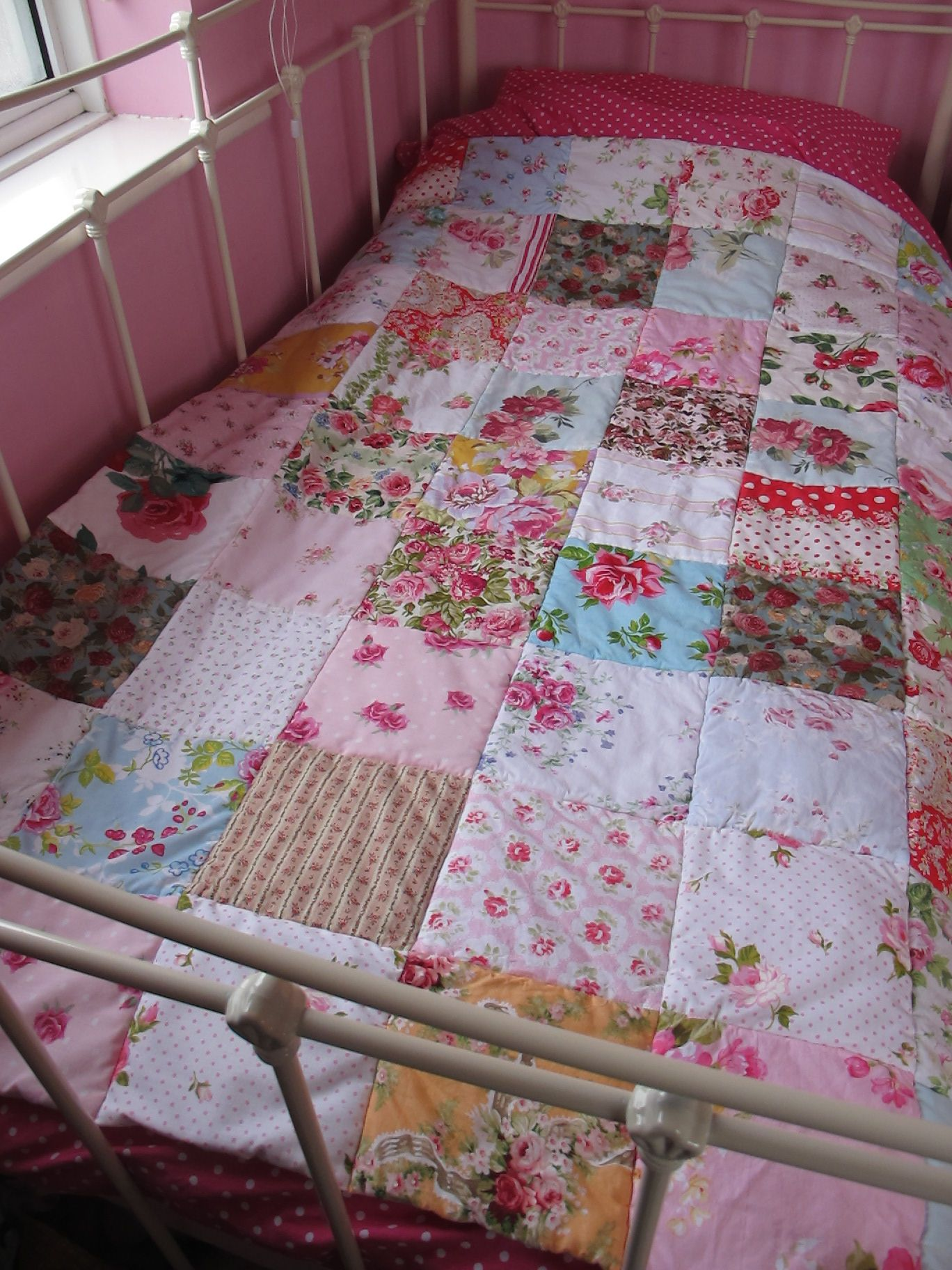 Vintage and upcycled fabrics in this cosy patchwork eiderdown