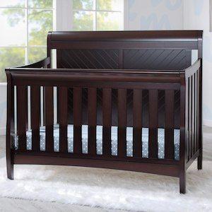Create A Nursery Youll Love With The Bennington Elite Sleigh Convertible Crib In Dark Espresso From Delta Children Its Graceful Style Headboard