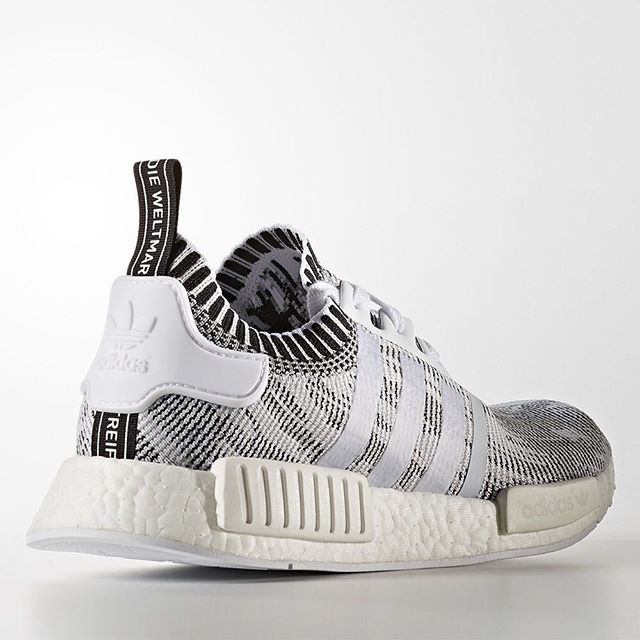 Glitch Camo is back on the adidas NMD R1 Primeknit. Do you prefer with or