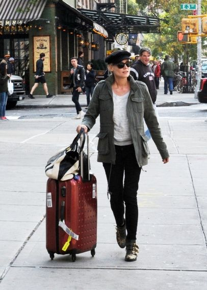 Diane Kruger is all smiles as she checks out her downtown hotel The Bowery in New York City. 10-10-2012
