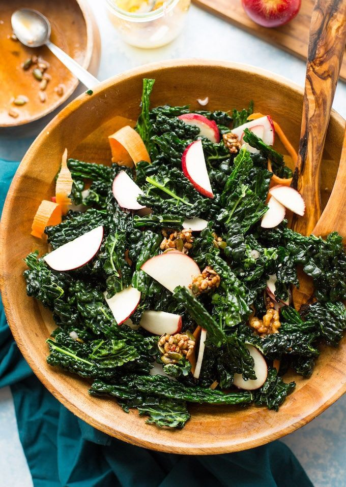 Crunchy kale apple salad with strips of carrot and maple toasted nut and seed clusters topped with a simple shallot vinaigrette. | Gluten Free + Paleo + Vegan