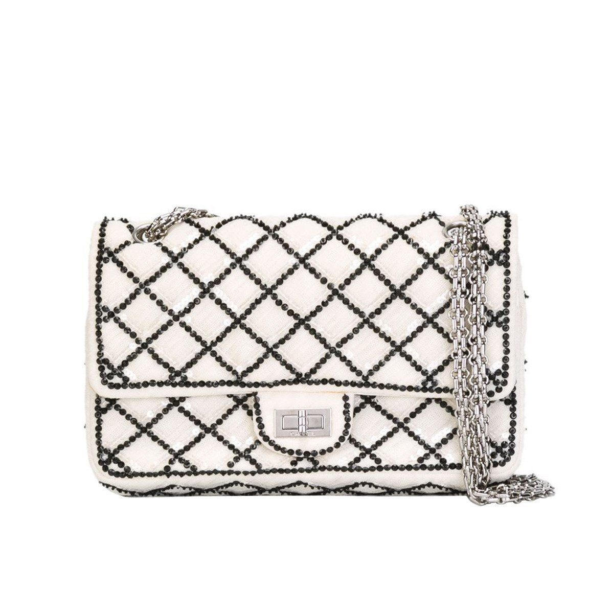 d12de991b096 For Sale on 1stdibs - This white and black cotton sequined flap shoulder bag  from Chanel features a foldover top with twist-lock closure, a quilted  effect, ...