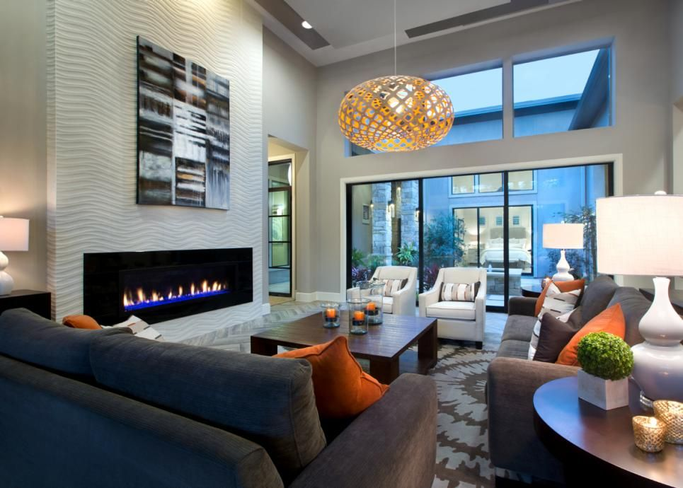 High Ceilings And Large Windows Make This Contemporary Family Room Feel  Grand. A Chic Gray