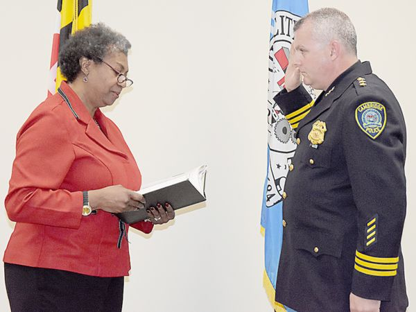 """CAMBRIDGE — Cambridge police officer Mark K. Lewis took the oath of office again on May 5, and will be assuming the role of acting police chief for this city, following the retirement of Chief Daniel Dvorak last month. The role will be """"acting police chief"""" because Chief Lewis is scheduled to retire in January …"""