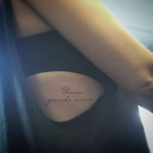 Unico grande amore tattoo on the right ribcage...